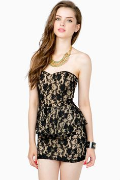 A great nighttime dress thats sweet and sassy. Lace overlay. Contrast lining. Sweetheart neck. Peplum waist. Short hem. Concealed zip closure in the back.