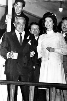Jackie wearing a Valentino dress for her wedding to Aristotle Onassis in 1968.