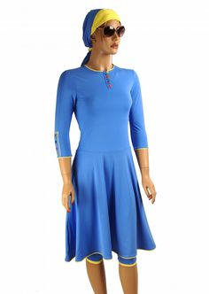 The Ocean flared dress is a very elegant modest swimdress. You will adore its very flattering shape and its very summery Blue Ocean color. It comes with matching tights that go below the knee (t