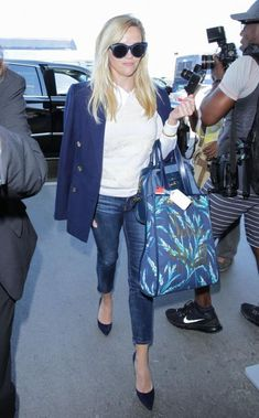 Reese Witherspoon wearing Tiffany & Co. Tiffany T Wire Bracelet, Draper James Lady Satchel in Cadet, Draper James Key Fob, Draper James Love Field Vanderbilt Tote and Draper James Lace Stripe Augusta Sweater