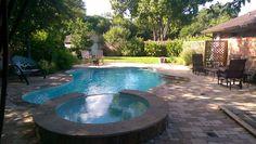 Poolside pavestone patio with pavestone edging.