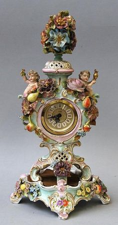A German porcelain mantel clock and stand, the