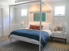Before and After: A Family Home Receives a Bold Boho Transformation//canopy bed, water photography, eclectic bedroom