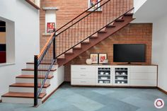 Staircase vastu allow you to position your staircase in a way that promotes the flow of positive energy. Get a headstart with these staircase design tips. Tv Unit Interior Design, Tv Unit Design, Room Interior, Design Your Dream House, House Design, Door Design, Cabinet Design, Cabinet Under Stairs, Modern Tv Cabinet