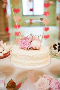 super cute simple wedding cake with heart bunting