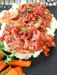 Oven Roasted Swiss Steak is slow simmered in the oven. Roasted tomatoes, onions and garlic caramelize over cube steak, cooked to fork tender perfection.
