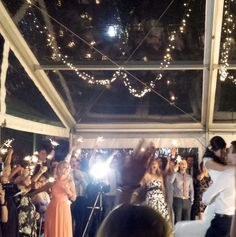 For outdoor dance floors, why not consider sparklers during the first dance? This was an amazing moment to be a part of. Because who doesn't love sparklers right?