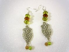Silver Owl Earrings with Green and Brown beads. $14.00, via Etsy.