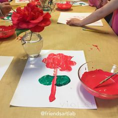 Morning art provocation: fresh camellias from the garden, custom-matched paint, paper, and freedom. #amomentwithfriends #processart #painting #nature #paintingnature #artteacher #kidsandart #preschool #preschoolteacher #flowers #camelia