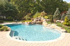 I love pools like this with curvy borders and rock water features