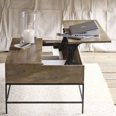 If you're like us and enjoy serving appetizers in your living room, but realize your coffee table is too low, West Elm has the solution with this hip coffee table that raises high enough to serve hors devours or use as a computer table!