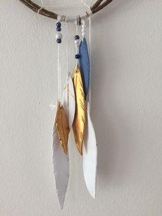 Dromenvanger veren klei goud