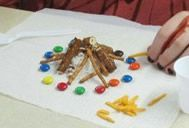 Edible Campfire explaining the steps to girls then eat it up!! How adorable!!!