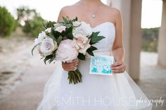 This gorgeous bridal bouquet of blush and white blooms was designed by Flower Shack Blooms based in San Antonio, Texas for a Chapel Dulcinea elopement. This elopement was featured on BLOVED Wedding blog. The watercolor painting of Chapel Dulcinea was hand-painted by Nib & Pixel. The dress shown is a two-piece dress by Pure Magnolia.