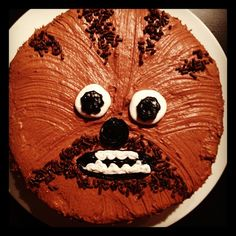 Chewbacca cake - marshmallows for whites of eyes, sprinkles for contrast fur.  Silicone basting brush used to create fur pattern in the icing.
