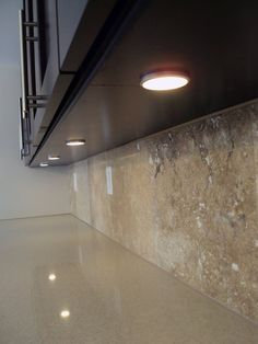 IKEA's Dioder under cabinet LED lighting is used in the kitchen. I love how low-profile these pucks are.