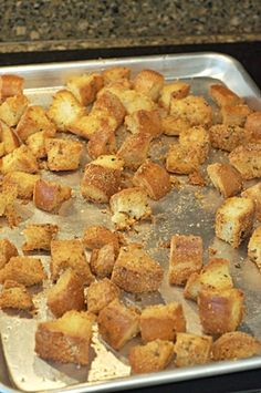 Homemade Croutons  Ingredients:  1 small loaf of day-old French bread 1/2 tsp. salt 1/2 tsp. ground black pepper 1/2 tsp. garlic powder 1 tsp. oregano 1/3 cup grated Parmesan cheese 1/4 cup olive oil  Toss bread cubes until evenly coated with seasonings and oil. Place the seasoned bread cubes on a baking sheet in 350 degree oven for 30 minutes or so.
