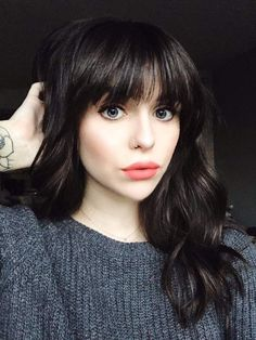 This chick is gorgeous. Love her makeup and hair but I can't pull off bangs