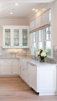 glass fronted kitchen cabinets with different color interior