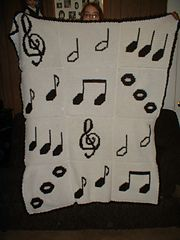 Ravelry: Music afghan pattern by Christine Frazier I'd do in different background color...not sure what color yet.