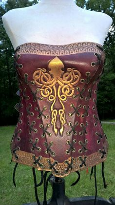 Check out this item in my Etsy shop https://www.etsy.com/listing/291096471/hand-tooled-leather-corset-with-kraken