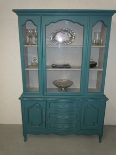 Painted china cabinet inspiration.  Pretty peacock blue.