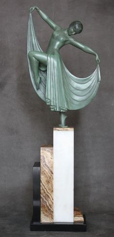 """Another variation of the art deco figure by Gilbert this time on a """"skyscraper"""" marble base."""
