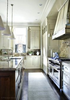 two-tone kitchen design with floor to ceiling ivory shaker cabinets