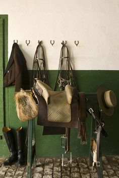 A tackroom in Portugal. Does anyone know what kind of saddle is pictured here?