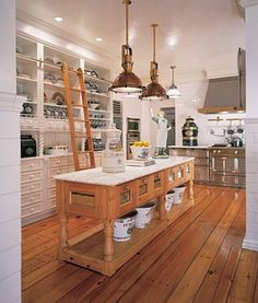 Inspiration for our DIY kitchen remodel… I love the idea of using salvaged or repurposed materials in place of a traditional kitchen island.