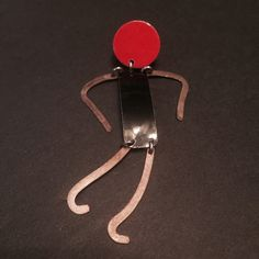 """Vintage Dangling Person Pin Tac Very fun and cute vintage Tac pin! Black and red enamel for the head and body and silver-tone arms and legs are on this Dangling Person Tac Pin. Measures approx. 3"""" tall and a little over a 1/2"""" wide. In great preowned vintage condition. Vintage Jewelry Brooches"""