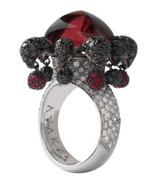 Avakian Joker ring set with rubellites and black and white diamonds.