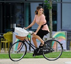 On your bike: Kelly decided to wear a city chic outfit as she promoted Sky Ride in Manchester, earlier today