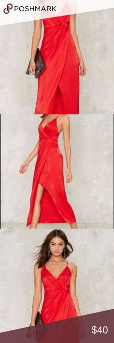 Red slip/wrap dress Sexy red satin dress perfect for summer. Could be dressed up or down. This dress is lined, made well. Straps are adjustable. Nasty Gal Dresses