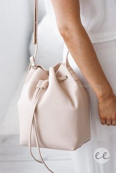 The perfect addition to any outfit, the Valentina Bucket Bag in Nude is that bag you can't live without!fit: attachable smaller pouch inside bag, adjustable shoulder strapcolour: nude with gold hardware, matching nude lining on the inside of the bag fabric: 100% PU