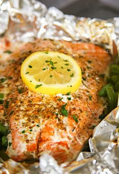 Garlic Butter Salmon is a simple foil packet dinner recipe that's oven-baked for a quick & healthy dinner or made on the grill at your next backyard BBQ. Salmon Recipes, Seafood Recipes, Seafood Meals, Lower Carb Meals, Low Carb, Foil Packet Dinners, Butter Salmon, Salmon And Asparagus, Easy Family Meals