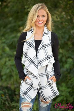 This stunning vest is simply a perfect layering piece for fall! We adore the beautiful black and white plaid print - it's a classic look that is sure to last for years! The material is soft and lightweight, while the asymmetrical draped look is just fabulous!