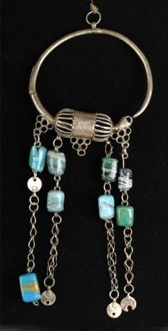 Palestine/Oman | Earring; Silver, glass beads and chain. | ca 1900 - 1930 || Worn by the Bedouins