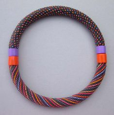 Hildegund Llkerl.  Magnetic closures allow two bracelets to become a necklace.
