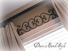 iron scrolls above window molding
