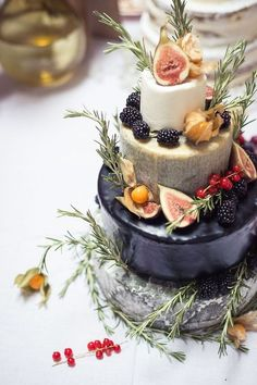 A tiered cake of cheese with fruit. Lovely.