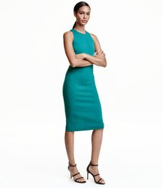Teal. Fitted, knee-length, sleeveless dress in thick jersey with a concealed zip and slit at back.