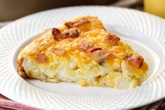 Preparation time: 15m Time of cooking: 20m Total time: 35m Ingredients: 260 g. flour 1 teaspoon salt 1 tablespoon baking powder 2 tablespoons sugar 50 g. butter 300 g. grated cheese 100 g. finely chopped spring onion 12 slices of bacon 250 ml. plus...