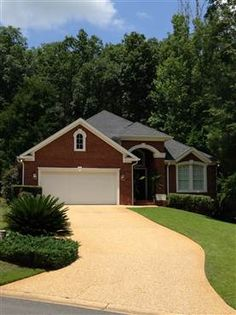 """9134 Eagles Ridge Drive #Tallahassee, #FL 32312  This is a """"turn-key home"""", low maintenance, elevated lot, upgraded brick & mortar, black roof for """"new look"""", New Brazilian Cherry hardwood floor, Cherry Diamond cabinets, tile bathroom & kitchen, huge remote gas fireplace, open floor plan, 50 foot deck overlooking acres of green space & lake, steel Kitchen Aid appliances, Cambria countertops, 4 bedroom 2.5 bath, new paint, 7.1 surround sound. #Florida #RealEstate"""