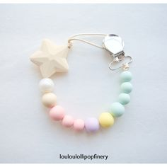 Shooting Star silicone beaded pacifier clip in Signature Cotton Candy. Available @louloulollipopfinery on etsy.