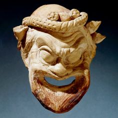 This terracotta model of a theatre mask is an example of the sort of evidence we…