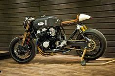 Honda CB 750 RC42 Cafe Racer | Oficina Honda cafe racer based on Honda CB 750 RC42 by Oficina MRS. This unique Honda CB 750 RC42 Cafe Racer features a custom cafe racer gas tank and a rear tail cowl made from carbon fiber giving the Honda CB 750 RC42 Cafe Racer a retro style, everything except engine and frame of this stock Honda CB 750 RC42 was modified. Honda CB 750 RC42 Cafe Racer features a new oil cooler, Kawasaki Zephyr 1100 swingarm, ducati wheel hubs, Ohlins suspension, Keihin CR…