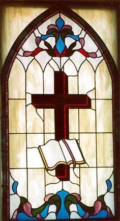 Cross and Bible - Stained Glass in the Church
