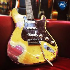 """#Straturday is the best day! Here's a Fender Custom Shop re-creation of a 1962 Stratocaster (from @guitarguitarlondon) Some people like the """"worn"""" look and others call it """"fake"""". What do you think? #Studio33Guitar"""