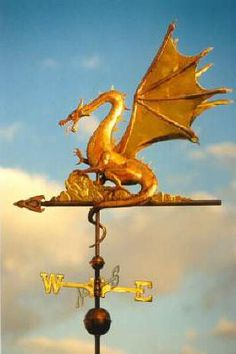 Dragon Weather Vane Web Wing Dragon by West Coast Weather Vanes.  The copper dragon weathervane has translucent topaz colored glass eyes. There can be blue, green and emerald eyed dragons. This weathervane has gold leafed teeth, tongue, horns, talons, wing claws, spines and belly. Optionally, this dragon weathervane can have gold leaf ribs in the dragon's wings or the actual wing panels between the ribs for an even more dramatic look.